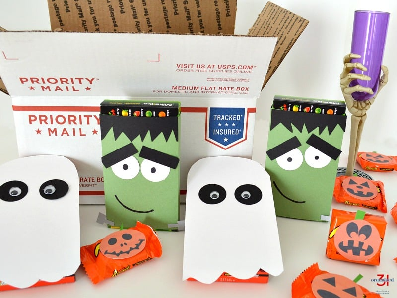 Close up of open postal shipping box with Halloween care package ideas