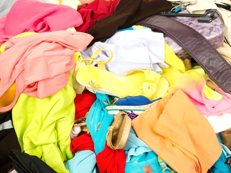 messy pile of colorful clothes and shoes