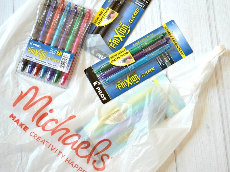 Michaels shopping bag with 3 different packs of Frixion pens