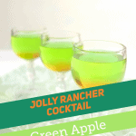 3 wine glasses of green and orange drink