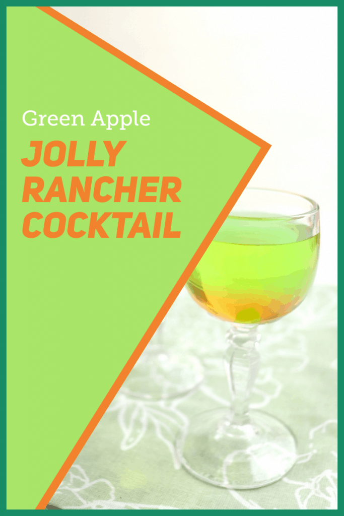 glass of green and orange drink on green table cloth