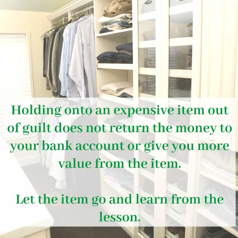 Neatly organized clothes closet with white shelves and text overlay reading Holding onto an expensive item out of guilt does not return the money to your bank account or give you more value from the item. Let the item go and learn from the lesson.