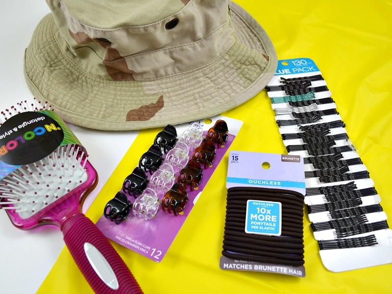 Desert military hat with women's hair care products scattered around