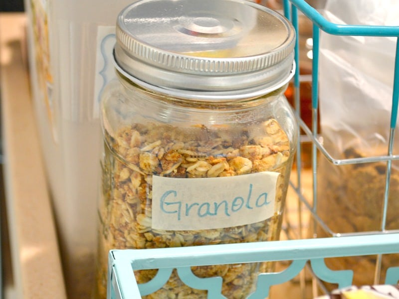 "close up of glass storage jar with ""granola"" label"