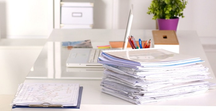 paperwork stacked on desk
