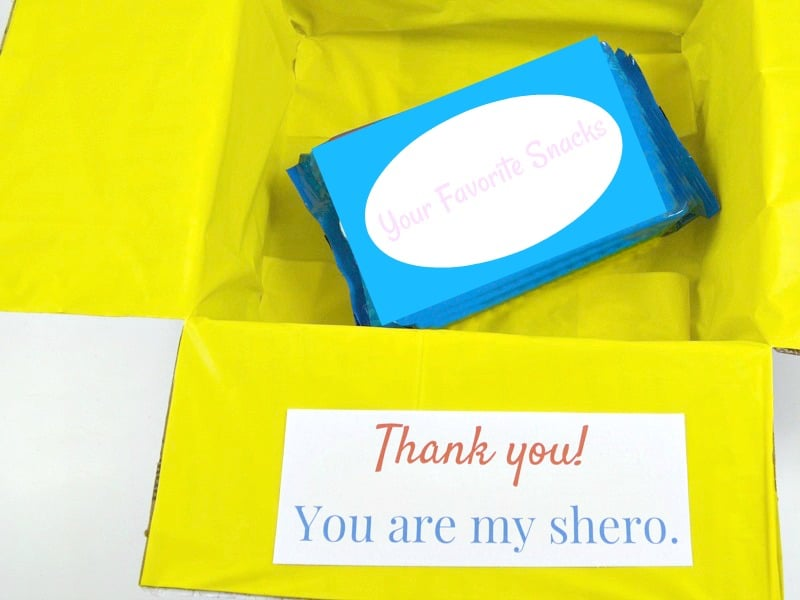 "decorated with bright yellow gift box with ""Thank you! You're my shero"" tag"