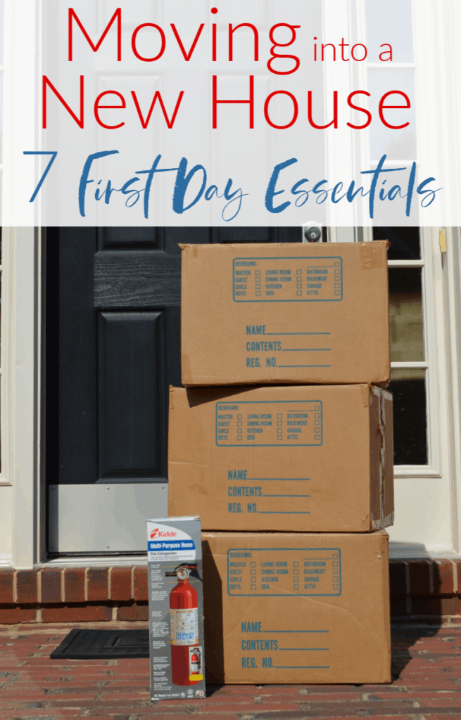 3 boxes stacked  by front door with fire extinguisher box