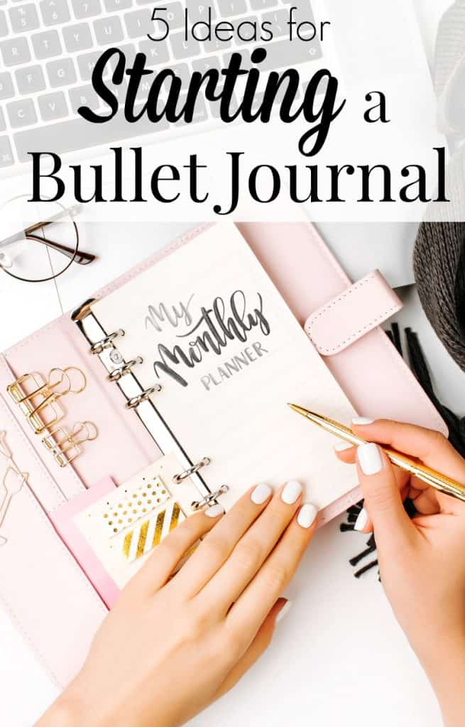 Monthly planner page of pink bullet journal with woman's hands and text overlay