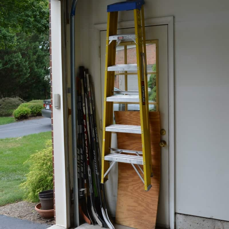 yellow ladder hanging on wall in front of door