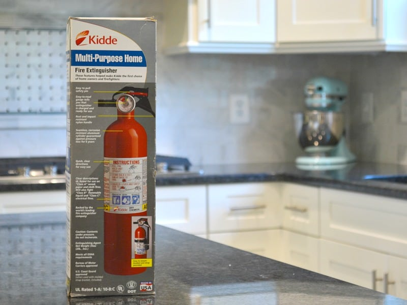 Fire extinguisher in box on kitchen counter