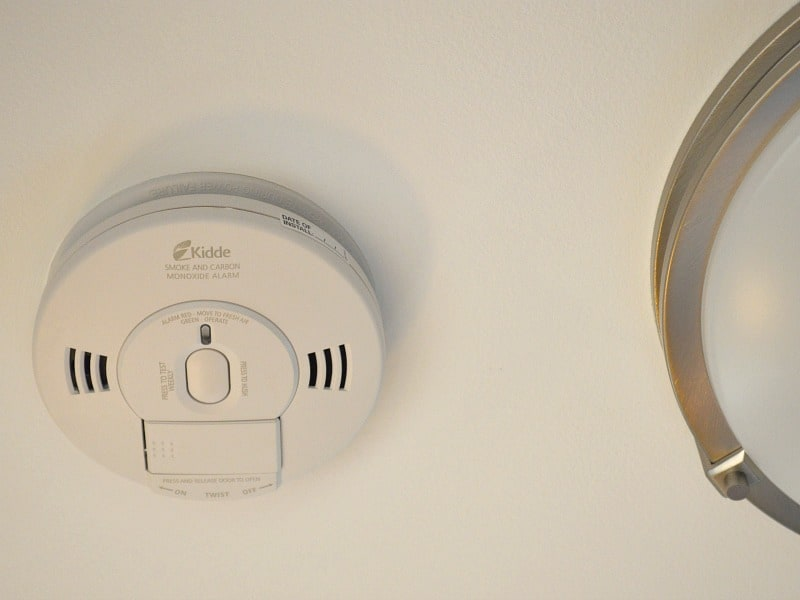 Close up of smoke alarm and edge of light fixture