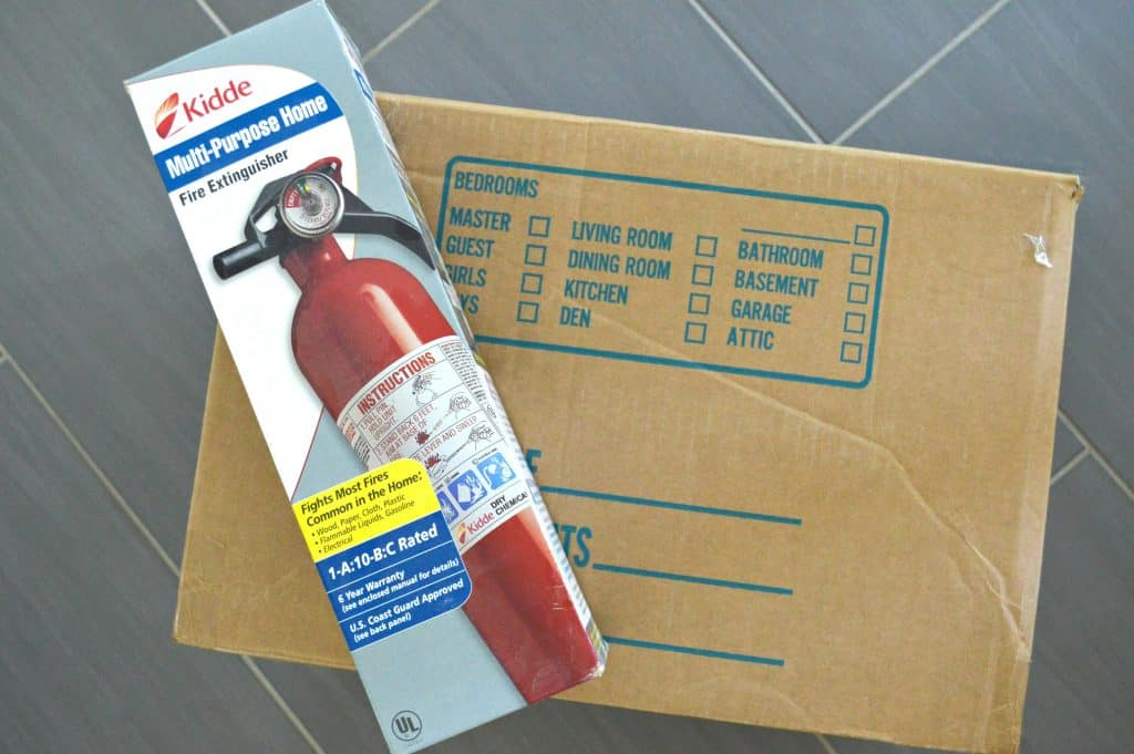 Fire extinguisher box on top of moving box