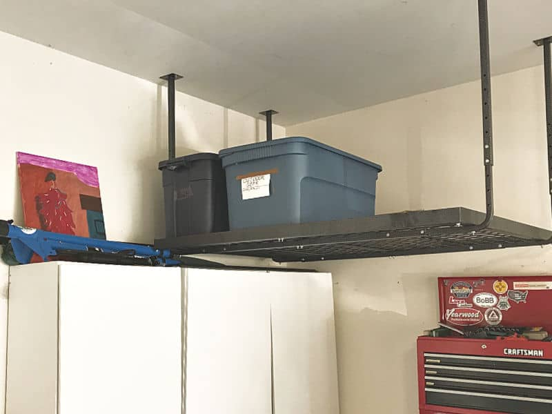 overhead garage storage shelf with 2 blue bins