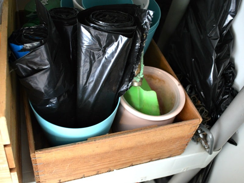 Plant pots in wood box holding items