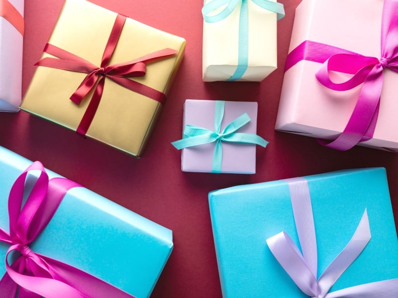 the perfect gift wrapped in brightly colored paper with bows