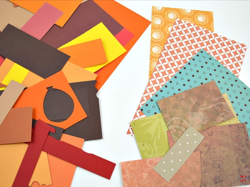 pile of colorful craft paper on white table