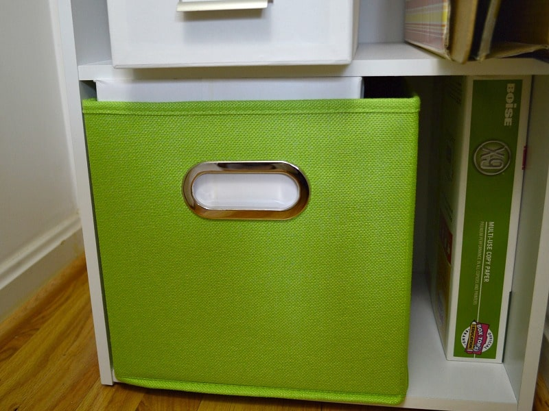 bright green fabric bin holding printer paper