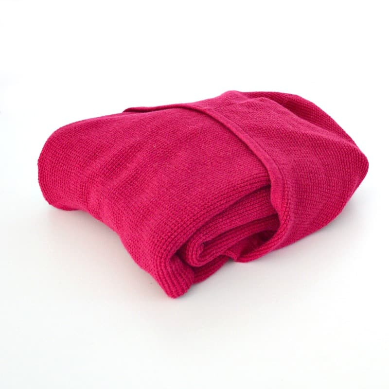 side view of folded pink hoodie folded
