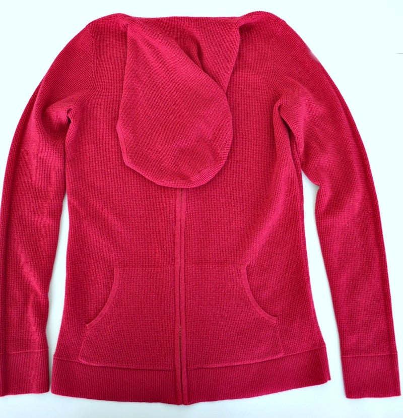 Pink hoodie with hood folded down neatly.