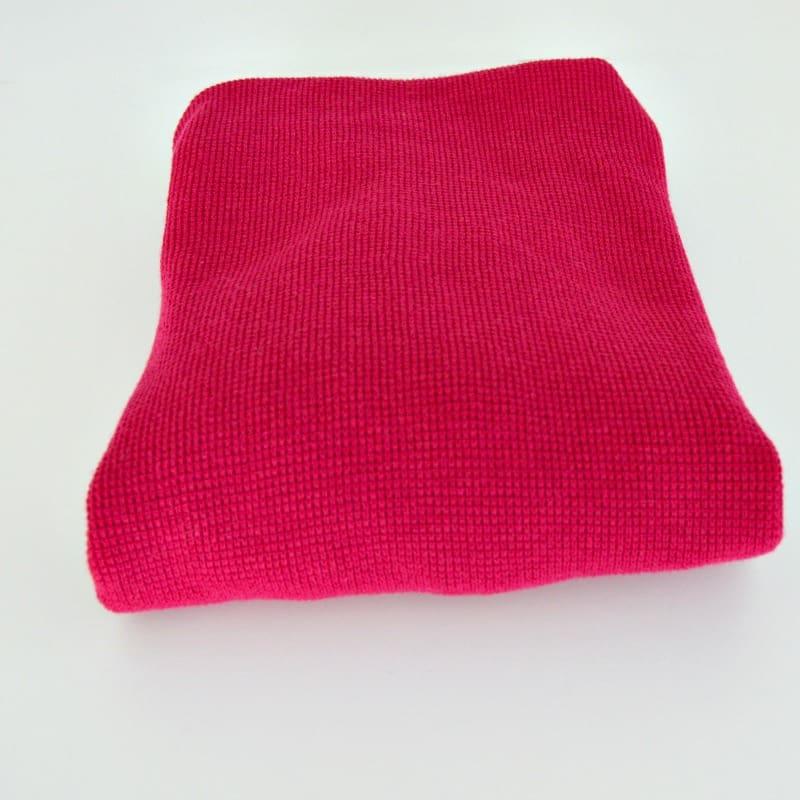 pink folded sweatshirt