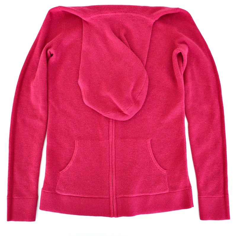 Pink hoodie with the hood folded down onto the body of the hoodie.