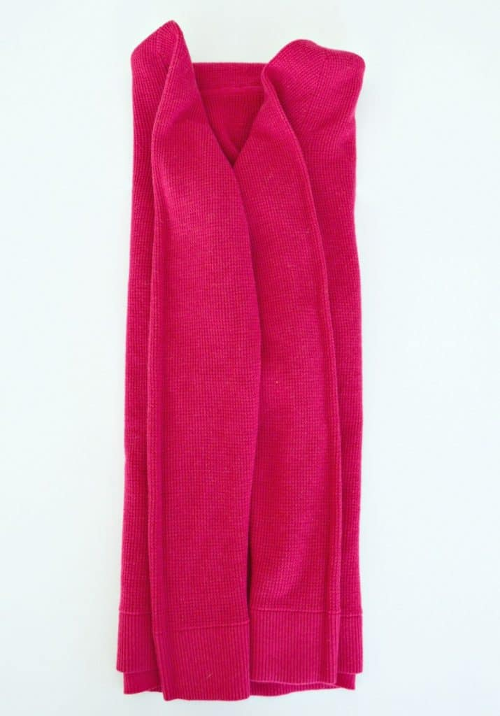 Pink hoodie with both sides and sleeves folded neatly into the middle of the hoodie.