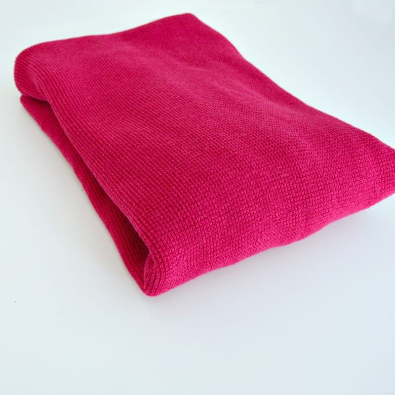 side view of folded pink sweater