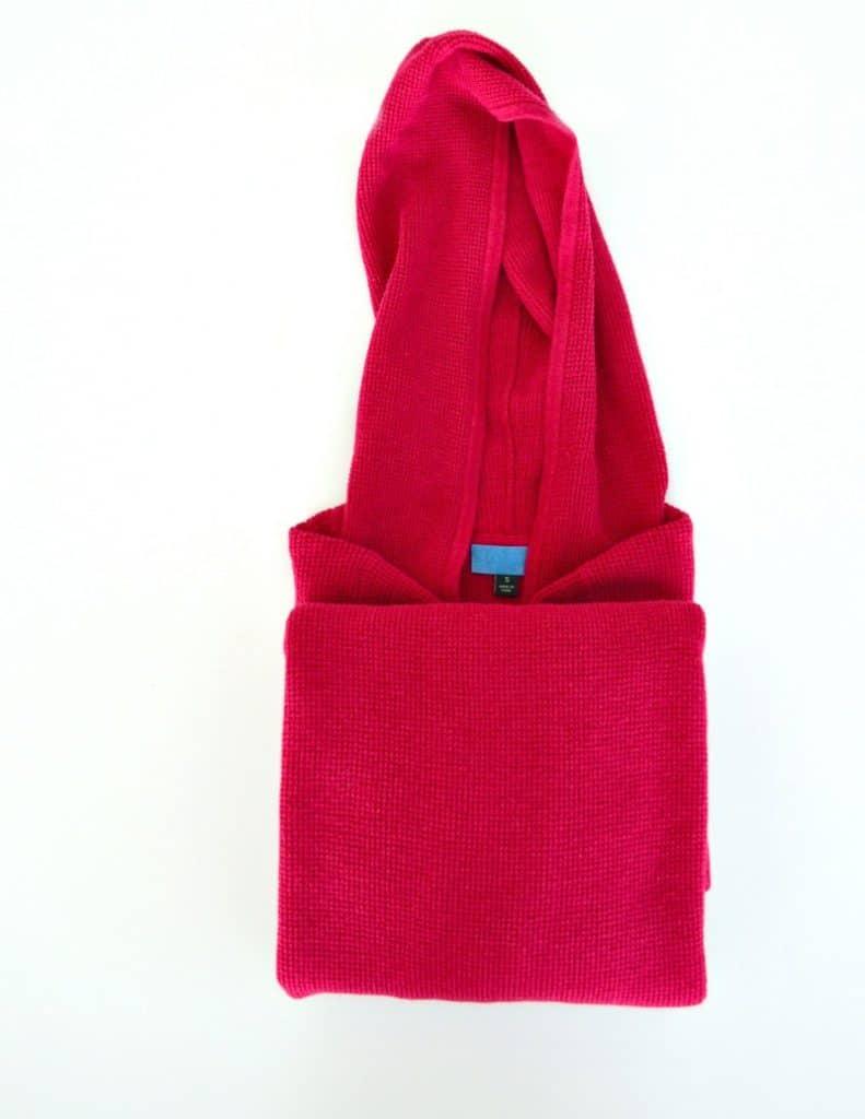 pink hoodie being folded