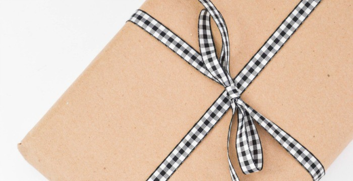 gift with brown paper and black and white ribbon bow