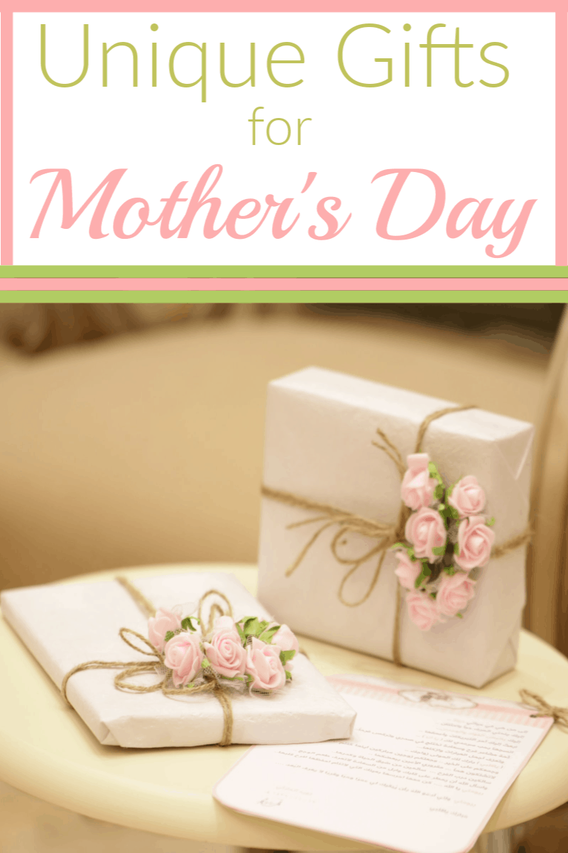 2 gifts wrapped in white paper with twine, pink flowers and greenery