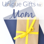Brown paper wrapped gift with yellow ribbon on navy blue wrapped gift with text overlay
