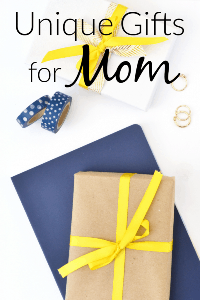 a brown present on a blue background and a white present on a white background next to tow rolls of blue and white washi tape and 3 gold rings with title text reading Unique Gifts for Mom