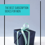 black box with blue ribbon on white table with box line box overlay
