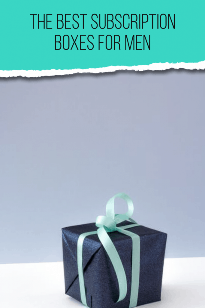 black box with blue ribbon on white table with green overlay on top