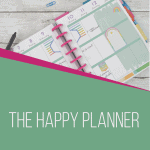 happy planner calendar with paper clips and pens and green and pink box overlays