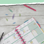 happy planner calendar with paper clips and pens and green and white torn edge overlays