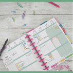 happy planner calendar with paper clips and pens and green box overlays