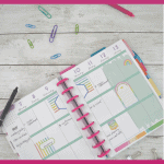 happy planner calendar with paper clips and pens and pink box overlays