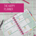 happy planner calendar with paper clips and pens and pink box overlay