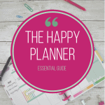 happy planner calendar with paper clips and pens and pink circle overlay