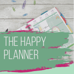 happy planner calendar with paper clips and pens and pink and green paint overlays
