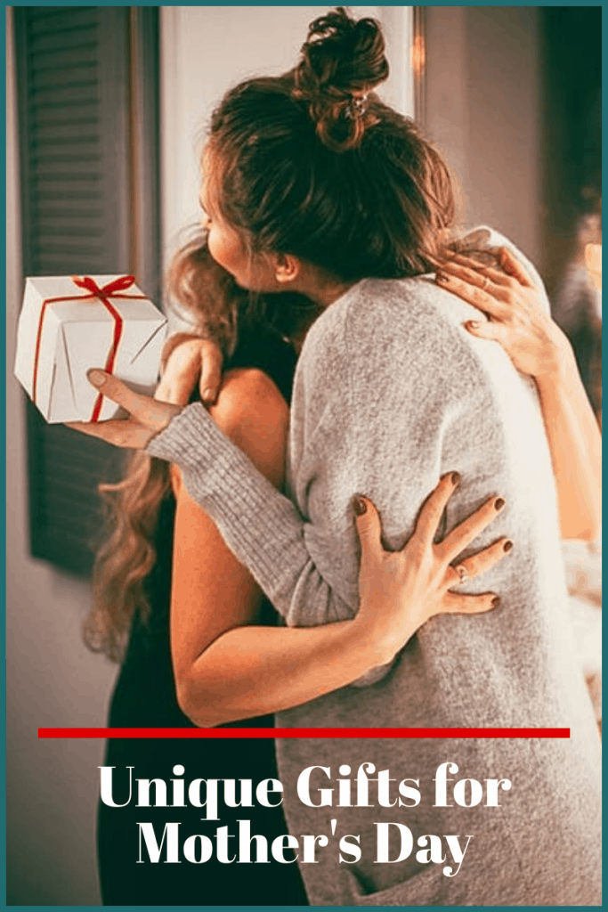 mother hugging daughter with box in her hand