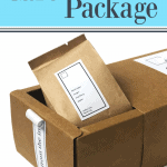 open box with brown craft paper food bag and white lable