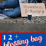 "man laying on sidewalk with cardboard sign that says ""homes & hungry"""