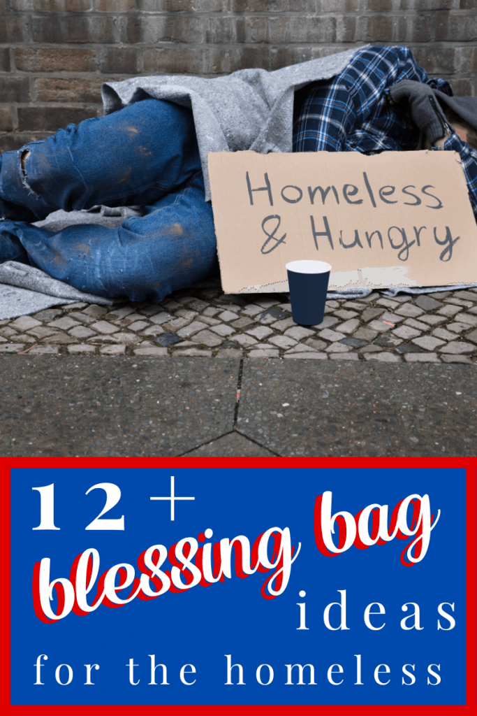 """man laying on sidewalk with cardboard sign that says """"homes & hungry"""""""