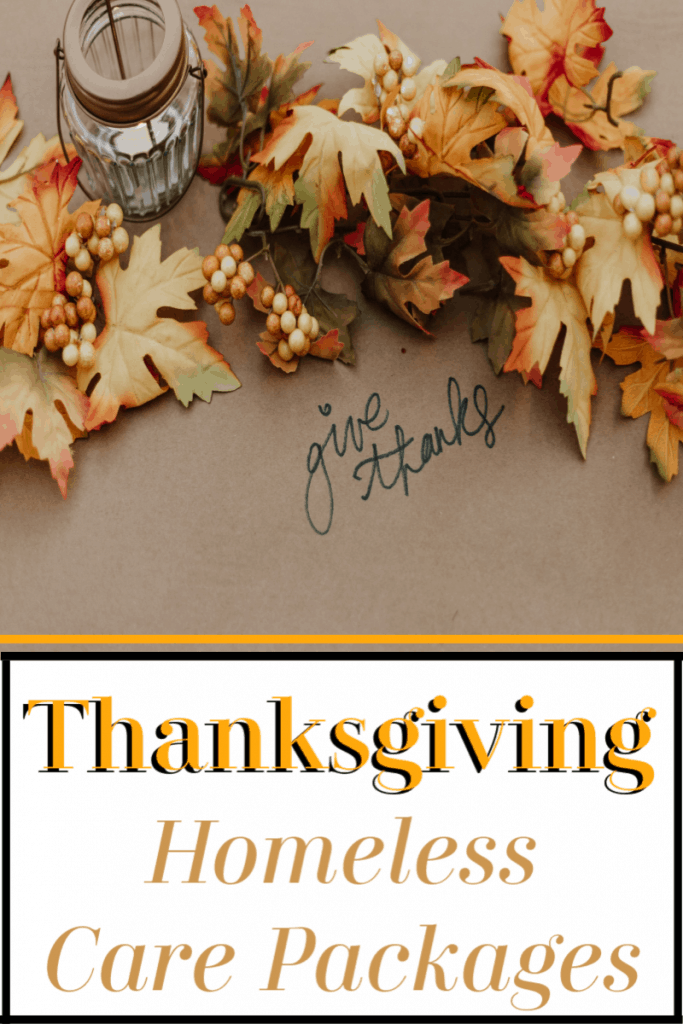 """autumn leaves and lantern on brown table with """"give thanks"""" in black ink with title text reading Thanksgiving Homeless Care Packages"""