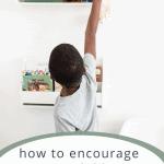 boy reaching to put book away in shelf on wall