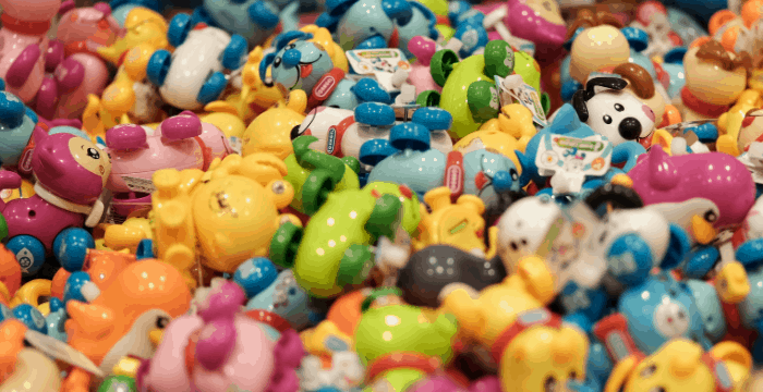 pile of brightly colored plastic toys