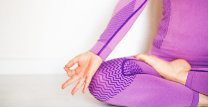 woman in purple clothes doing yoga pose