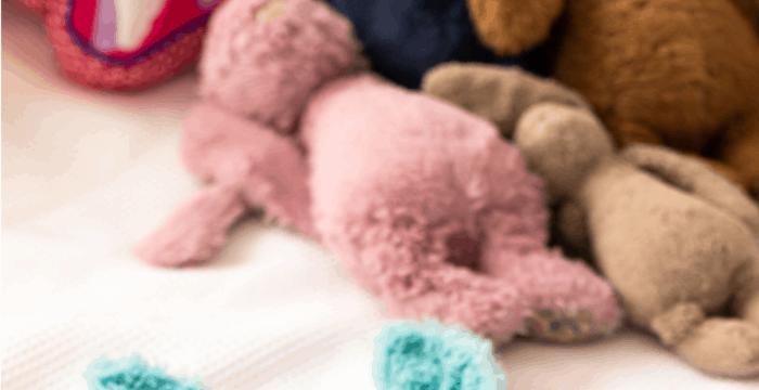 pile of stuffed animals on white sheet